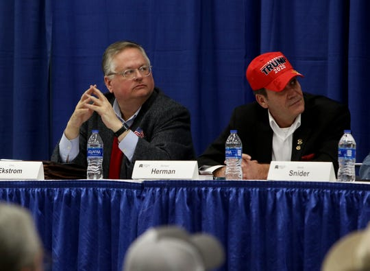 Chris Ekstrom, left, and Richard Herman take part in a candidate forum for the 13th District Congressional race sponsored by the Wichita County Republican Party Wednesday, Feb. 12, 2020, in the Ray Clymer Exhibit Hall at the MPEC.