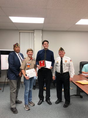 Students from Holliday ISD were recognized at the Monday, Feb 10, 2020 monthly school board meeting for their accomplishments in the Veterans of Foreign Wars (VFW) Patriot's Pen and Voice of Democracy scholarship competitions. From left to right: Dr. Carl Lilly, Commander, VFW District 15; Bryce Palmer, Holliday Middle School, District 15 Patriot's Pen 3rd place winner; Caleb Faver, Holliday High School, District 15 Voice of Democracy 1st place winner and state of Texas finalist; David Teichman, Quartermaster, Scotland-Windthorst Post 2676. Caleb's first place at District 15 earned him a $500 college scholarship and he received a $1000 college scholarship for being a VFW state finalist.