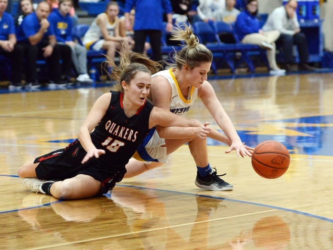 Audrey Harr, left, of New Philadelphia, and Maysville's Macie Jarrett dive after a loose ball during the second quarter of the Panthers' 58-43 win on Tuesday in Newton Township.