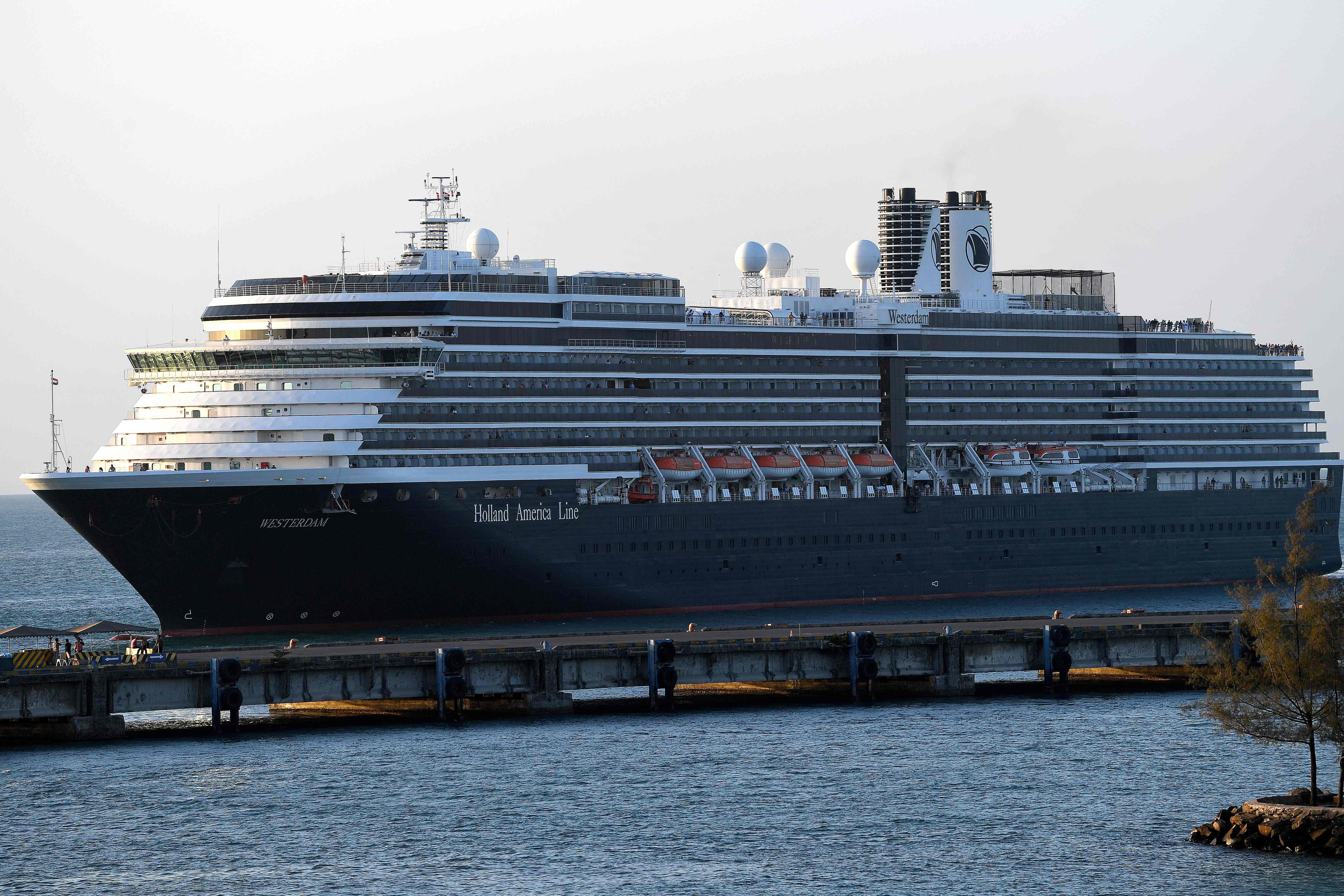 First Holland America cruise ship passengers begin to disembark in Cambodia