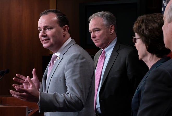 From left, Sen. Mike Lee, R-Utah, Sen. Tim Kaine, D-Va., and Sen. Susan Collins, R-Maine, speak to reporters just after the Senate advanced a bipartisan resolution asserting that President Donald Trump must seek approval from Congress before engaging in further military action against Iran on Feb. 12, 2020.