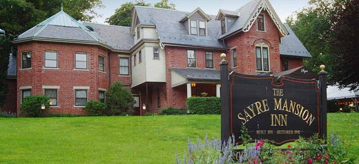 """<a href=""""https://www.historichotels.org/hotels-resorts/the-sayre-mansion""""><strong>The Sayre Mansion </strong></a>(1858) &bull; Bethlehem, Pennsylvania &bull; This Victorian-era mansion lends itself to romance and elegance. Popular proposal options include the formal parlor with its original marble fireplace, intricate woodwork and period furnishings. Couples may also choose the front veranda with its sweeping views of historic Bethlehem. The former library of the home&rsquo;s original owner is now a two-room suite that boasts a separate sitting room with the original vaulted ceiling and chandelier, floor-to-ceiling bookshelves and an electric fireplace with marble surround."""