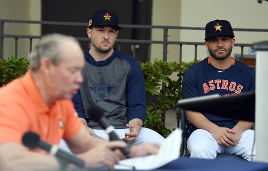 Alex Bregman and Jose Altuve listen as owner Jim Crane speaks during a news conference Thursday.