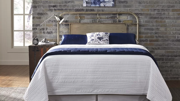 This distressed headboard looks worn in the right way.