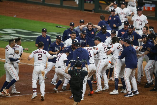 Astros second baseman Jose Altuve (27) hit a walk-off home run off Yankees closer Aroldis Champan to send Houston to the 2019 World Series.