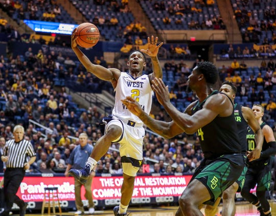 West Virginia guard Brandon Knapper drives to the basket during the second half of his team's game against Baylor in 2019.