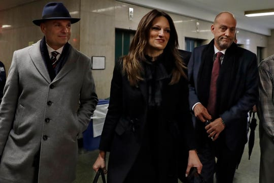 Harvey Weinstein's defense attorneys Donna Rotunno and Arthur Aidala, left, arrive for closing arguments at his sex-crimes trial in New York, Feb. 13, 2020.