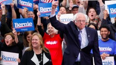 Democratic presidential candidate Bernie Sanders and his wife,  Jane O'Meara Sanders, celebrate in Manchester, New Hampshire, on Feb. 11, 2020.
