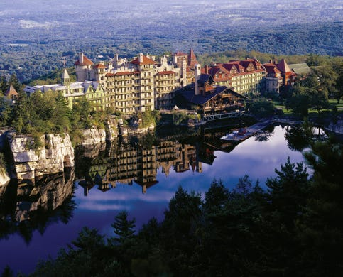 """<strong><a href=""""https://www.historichotels.org/hotels-resorts/mohonk-mountain-house"""">Mohonk Mountain House</a></strong> (1869) &bull; New Paltz, New York &bull; Mohonk Mountain House is a Victorian castle perched at the top of a mountain with a private lake. The hotel has 120 &ldquo;summerhouses,&rdquo; which are rustic gazebos designed for two people to share special moments together; taking in stunning views during or after a hike on 85 miles of trails. The Sky Top Tower is a hiking destination with panoramic views of the Shawangunk Cliffs and Catskill Mountains and a popular engagement site, along with the boat dock, which provides amazing views of serene Lake Mohonk."""