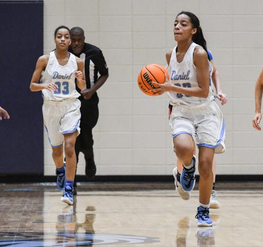 D.W. Daniel senior Jada Young(33) follows twin sister D.W. Daniel senior Jasmine Young(30) passing the ball during the second quarter at D.W. Daniel High School in Central on Thursday.