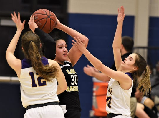 Wylie's Caroline Steadman, right, and Karis Christian, left, pressure Wichita Falls Rider's Addison Self during the second half. Rider beat the Lady Bulldogs 48-32 in the District 4-5A playoff seeding game Thursday, Feb. 13, 2020, at Graham.