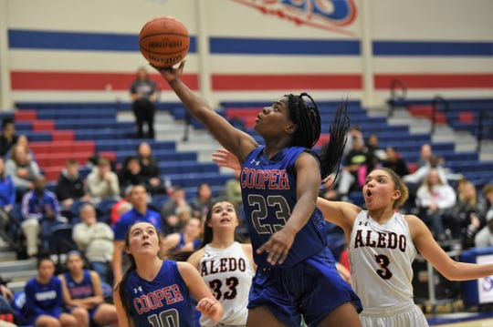 Cooper's Dazz Larkins (23) extends for a layup against Aledo during the District 4-5A seeding game Thursday in Graham. The Lady Cougars fell 32-24 and will play Wylie for the district's No. 3 seed Friday at Abilene High.