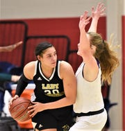 Wichita Falls Rider's Addison Self, left, looks to pass around a Wylie defender. Rider beat the Lady Bulldogs 48-32 in the District 4-5A playoff seeding game Thursday, Feb. 13, 2020, at Graham.