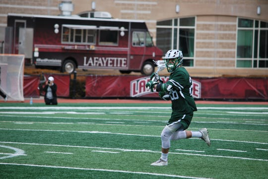 Binghamton men's lacrosse midfielder Jackson Rieger makes a play against Lafayette on Feb. 23, 2019.