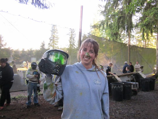 A paintball player shows off her mask at Northwest Paintball Park. The park's owners announced it would close this month after 20 years in business.