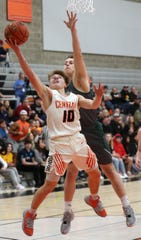 Central Kitsap's Colby White (10) goes up for a shot ahead of Peninsula's Trent Buchanan on Thursday, Feb. 13, 2020.