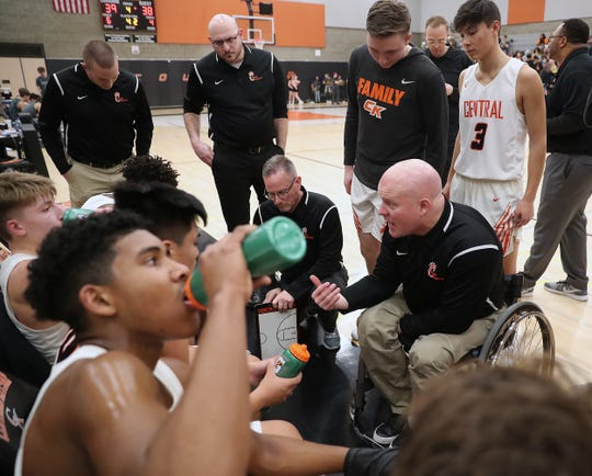Central Kitsap boys basketball coach Scott McMinds and the Cougars tip off at 9 a.m. Wednesday against Marysville-Pilchuck in the Class 3A state tournament at the Tacoma Dome.