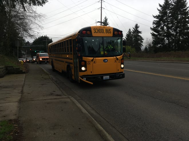 A South Kitsap School District bus stops at a driveway on Lund Avenue to drop off students on Feb. 13, 2020. Port Orchard police in early 2020 received reports of numerous bus paddle violations at the stop.