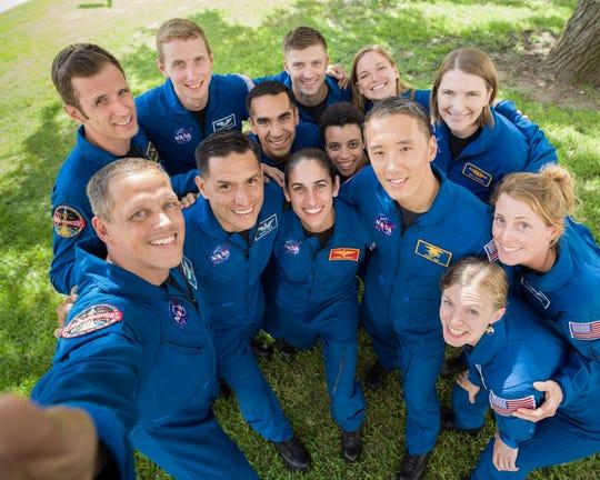 The members of the 2017 NASA Astronaut Class are (from left) Josh Kutryk, Bob Hines, Warren Hoburg, Frank Rubio, Raja Chari, Matthew Dominick, Jasmin Moghbeli, Jessica Watkins, Jenny Sidey, Jonny Kim, Kayla Barron, Zena Cardman, and Loral O' Hara.