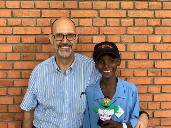Bruce Leavitt, MD, a cardiothoracic surgeon at University of Vermont Medical Center, placed two donated heart valves into the chest of a young Rwandan boy named Frankie (pictured) during Team Heart's annual volunteer trip to the country in dire need of cardiothoracic surgery.