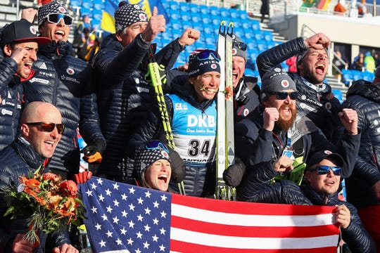 The U.S. team celebrates with Susan Dunklee of the U.S., center with flower in her mouth, after she took a second place in the women's 7.5km sprint competition at the Biathlon World Championships in Antholz, Italy, Friday, Feb. 14, 2020.