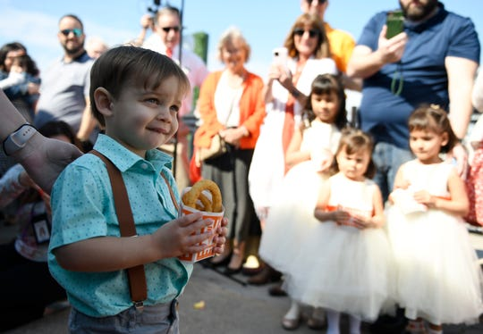 "The ""onion ring"" bearer walks down the aisle at the Whatawedding, Friday, Feb. 14, 2020. The wedding took place on the balcony."