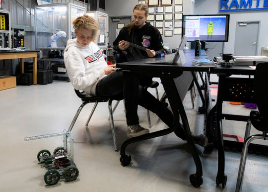 Unioto senior Ashton Kinnison, left, uses a remote control to show the versatility of a robot he and Isaac Butterbaugh are working on for their RAMTEC class at Pickaway-Ross on Feb. 13, 2020. The robot will compete with others in the class and possibly in the nation for Skills USA Urban Search and Rescue competition where robots will be used to remove explosive devices to safety.