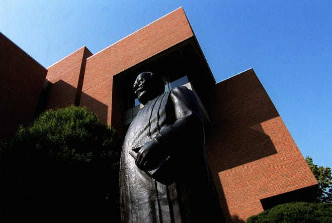 The exterior of the University of Cincinnati's College of Law, near Calhoun Street and Clifton Avenue on UC's main campus. A statue of President William Howard Taft, a Cincinnati native who also was chief justice of the U.S. Supreme Court and dean of the UC law school, stands outside.