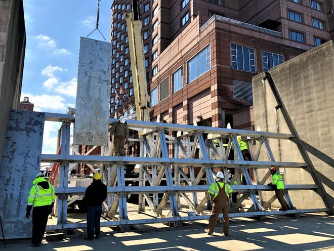 The Madison Overlook floodgate was up by 1 p.m. Friday, according to the City of Covington.