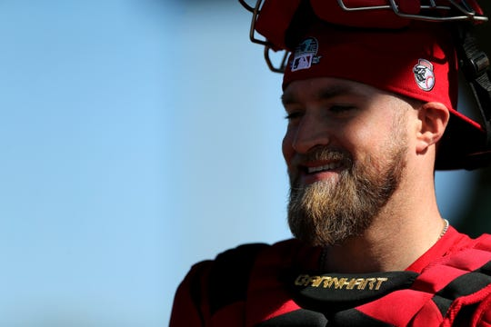Cincinnati Reds catcher Tucker Barnhart (16) smiles following a bullpen session, Friday, Feb. 14, 2020, at the Cincinnati Reds Spring Training Facility in Goodyear, Arizona. Pitchers and catchers reported to spring training on Friday. A handful of position players have arrived and participated in light workouts.