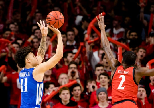 Memphis Tigers guard Lester Quinones (11) shoots a 3-pointer Cincinnati Bearcats guard Keith Williams (2) guards him in the first half of the NCAA mens basketball game on Thursday, Feb. 13, 2020, at Fifth Third Arena in Clifton.