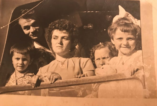 Elena Veloff (center) and her daughter, Vera, (far right) on a train to head to America in the early 1960s.