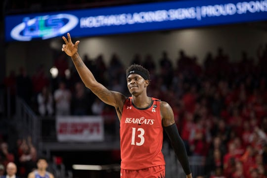 Cincinnati Bearcats forward Tre Scott (13) celebrates after hitting a shot in overtime of the NCAA mens basketball game on Thursday, Feb. 13, 2020, at Fifth Third Arena in Clifton. Cincinnati Bearcats defeated Memphis Tigers in overtime 92-86.