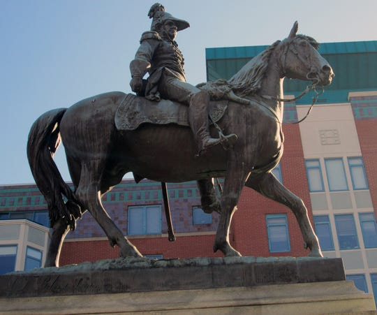 The statue of former President William Henry Harrison at Garfield Place and Elm Street, Downtown.