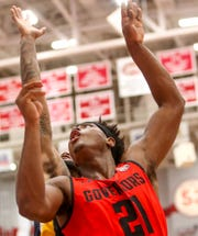 APSU's Terry Taylor (21) watches a layup he shot go towards the basket during an OVC conference basketball game between the Austin Peay Governors and Murray State Racers at the APSU Dunn Center in Clarksville, Tenn., on Thursday, Feb. 13, 2020.