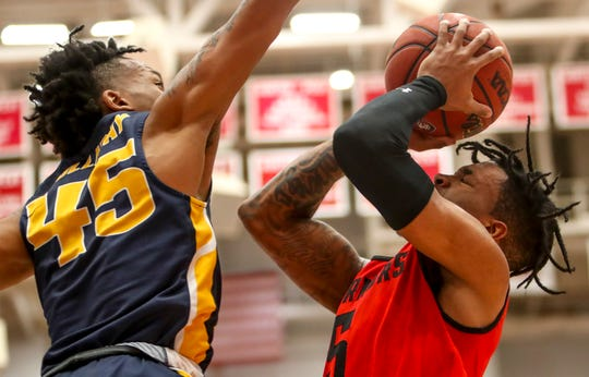 APSU's Jordyn Adams (5) squints before taking a shot past Murray's Jason Holliday (45) during an OVC conference basketball game between the Austin Peay Governors and Murray State Racers at the APSU Dunn Center in Clarksville, Tenn., on Thursday, Feb. 13, 2020.