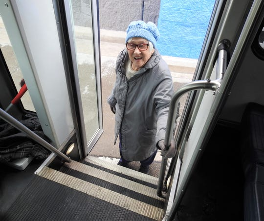 Donna Smith gets on the new public shuttle from Coshocton County Coordinated Transportation Agency. She picked up prescriptions and some groceries at Walmart before getting a new book to read at the Coshocton Public Library. She counts the new service as a blessing.