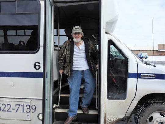 Dave Welch gets off of the new public shuttle at the Downtowner Plaza. Seniors so far have gotten the most use out of the service, with many no longer driving.