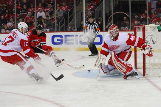 Detroit Red Wings goaltender Jonathan Bernier makes a save on New Jersey Devils left wing Miles Wood (44) during the second period Feb. 13, 2020 in Newark, N.J.