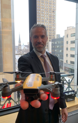 Michael Healander with a drone on Thursday at the Airspace Link office on Clifford Street in downtown Detroit.