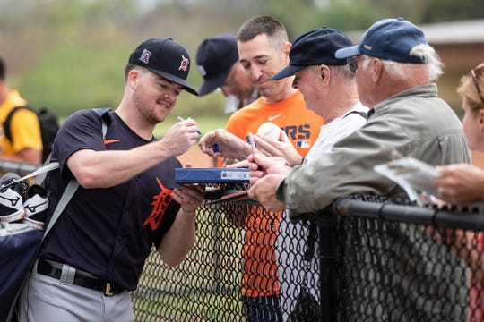 Catcher Jake Rogers signs autographs for fans during spring training at TigerTown in Lakeland, Fla., Friday, Feb. 14, 2020.