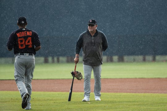Manager Ron Gardenhire watches practice in the rain during spring training at TigerTown in Lakeland, Fla., Friday, Feb. 14, 2020.