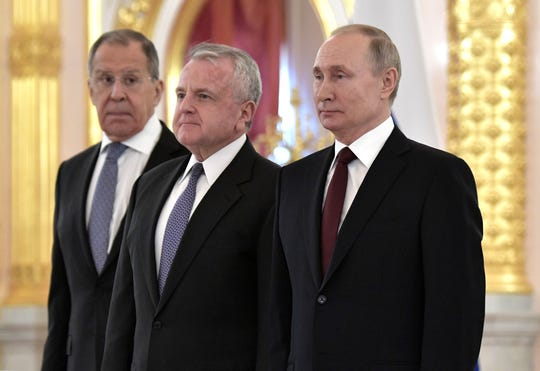 Russian Foreign Minister Sergei Lavrov, left,  U.S. Ambassador to Russia John J. Sullivan and Russian President Vladimir Putin attend a ceremony in the Kremlin in Moscow, Russia, on February 5, 2020.