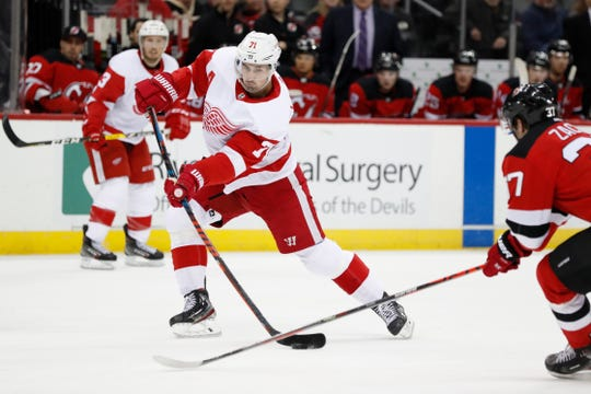 Dylan Larkin shoots vs. the Devils during the first period Thursday in Newark, N.J.