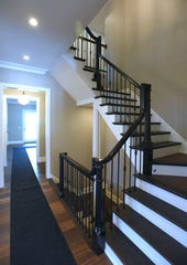 The staircase of the Birmingham Colonial listed for $1.895 million.