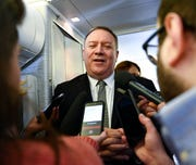Secretary of State Mike Pompeo takes questions from reporters during a flight from Andrews Air Force Base, Md., to Germany on Thursday, February 13, 2020.
