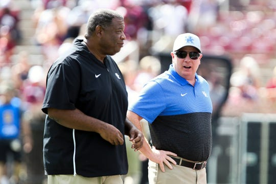 Kentucky associate head coach Vince Marrow, left, here with head coach Mark Stoops, announced on Twitter Friday he is staying in Lexington, Kentucky, despite overtures from new Michigan State coach and longtime friend Mel Tucker.