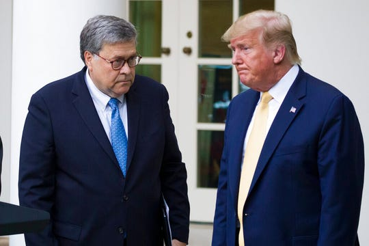 In this July 11, 2019, file photo, Attorney General William Barr, left, and President Donald Trump turn to leave after speaking in the Rose Garden of the White House.