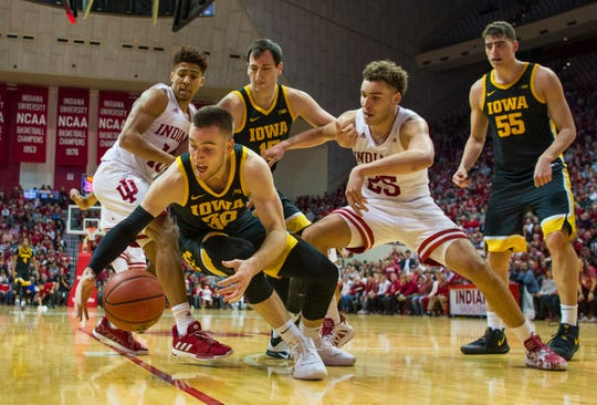 Iowa guard Connor McCaffery (30) falls on the ball during the second half.