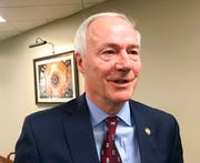 In this Jan. 13, 2020, file photo, Arkansas Gov. Asa Hutchinson speaks to reporters in Little Rock, Ark. A federal appeals court panel in Washington has upheld a lower court's decision that blocked the Trump administration's work requirements for Medicaid recipients.